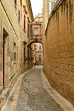 Narrow street in Mdina, Malta. Mdina city street view. It is a fortified city in the Northern Region of Malta, which served as the island's capital from Royalty Free Stock Photos