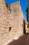 The narrow street of Mdina, the old capital of Malta. In the surroundings of limestone walls. The narrow medieval stone paved street of Mdina, the old capital Royalty Free Stock Photos