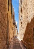 The narrow street of Mdina, the old capital of Malta. Royalty Free Stock Image