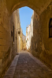 The narrow street of Mdina, the old capital of Malta. In the surroundings of limestone walls. The narrow medieval stone paved street of Mdina, the old capital Royalty Free Stock Photography