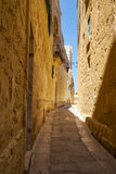 The narrow street of Mdina, the old capital of Malta. In the surroundings of limestone walls. The narrow medieval stone paved street of Mdina, the old capital Stock Image