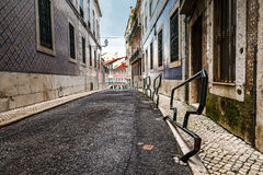 Narrow Street in the Medieval Alfama District of Lisbon Stock Photography