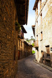 Narrow street in medieval Catalan village Stock Photos
