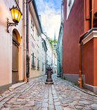 Narrow street in medieval city, Latvia, Europe Royalty Free Stock Image