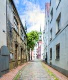 Narrow street in medieval city, Latvia, Europe Royalty Free Stock Photos