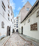 Narrow street in medieval city Stock Images