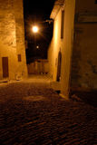 Narrow street in medieval town at night Royalty Free Stock Images