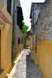 Narrow street in the medieval town of Rhodes. Stock Image