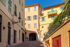 Narrow street in Menton, France. Royalty Free Stock Photo