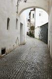 Narrow street in meran Stock Images