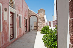 The narrow street in the midday on the island of Santorini, Oia. Greece. Stock Photo