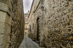 Narrow street of the Middle Ages in the historical center of Cac. Small streets for large historical buildings in the city of Caceres Spain Stock Photography