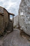 Narrow street of Monsanto vollage with rocks. Rocks, moss and doors of Monsanto village in Portugal Stock Photography