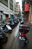 Narrow street. Motorbikes on a congested street in central Macau Royalty Free Stock Photos