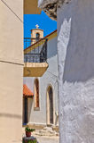 Narrow street at mountain village, island of Crete Royalty Free Stock Photos