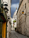 Narrow street near Montmartre, Paris. There are plenty of beautiful narrow streets in Montmartre district of northern Paris, France. This is the highest point in Royalty Free Stock Images