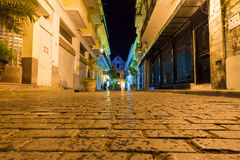Narrow street at night in Old Havana Stock Image
