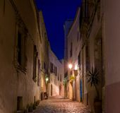 Narrow street at night Stock Photography