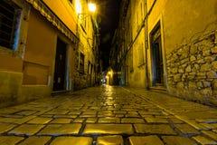 Narrow street in night of old town of Rovinj, Croatia stock photos