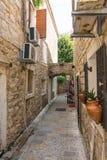 Narrow street of old Budva, Montenegro Royalty Free Stock Image
