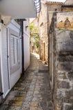 Narrow street of old Budva, Montenegro Stock Images