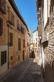 Street with old buildings on the medieval city of Toledo in Spain Royalty Free Stock Photography