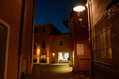 Narrow street and old buildings at night. Stock Photography