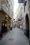 Narrow street and old buildings in Salzburg Stock Image