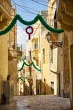 The narrow street of the old capital Vittoriosa Birgu decorate Stock Photo