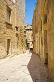 The narrow street of the old capital Vittoriosa Birgu, Malta. The narrow street of the old capital Vittoriosa Birgu in the surroundings of limestone walls. Malta Stock Photos