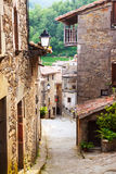 Narrow street of old Catalan village Royalty Free Stock Images
