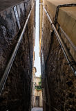 Narrow street in old city centre Royalty Free Stock Photo