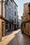 Narrow street in old city centre Royalty Free Stock Image