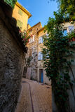 Narrow street in old city centre Stock Photography