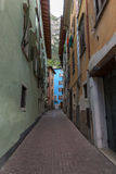Narrow street of the old city in Italy Stock Photography