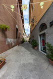 Narrow street of the old city in Italy Royalty Free Stock Photography