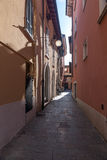 Narrow street of the old city in Italy Royalty Free Stock Image