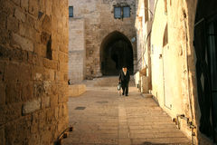 The narrow street in the Old City of Jerusalem. Old Jerusalem is one of most sacred towns in the world royalty free stock photos