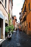 Narrow street in the old city on May 31, 2014, Rome Royalty Free Stock Photo