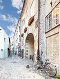 Narrow street in old city of Riga, Latvia Royalty Free Stock Image