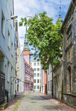 Narrow street in old city of Riga, Latvia Stock Photo