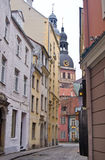 Narrow street in old city of Riga Stock Photos
