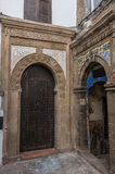 Narrow street, old doors and colorful old houses of medieval med Royalty Free Stock Image