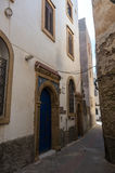 Narrow street, old doors and colorful old houses of medieval med Royalty Free Stock Images