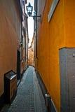 Narrow street of the old European city. Empty street of Gamla Stan. Old Town, Stockholm, Sweden Stock Photos