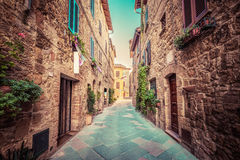 Narrow street in an old Italian town of Pienza. Tuscany, Italy. Vintage Royalty Free Stock Images