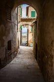 Narrow Street in an Old Italian Town. Tuscany, Italy. A narrow street in an old town in Tuscany, Italy Royalty Free Stock Photography