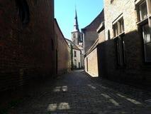 Narrow street of old medieval european city, Bruges, Belgium. royalty free stock photo