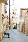 The narrow street in the old part of Malia. Royalty Free Stock Image