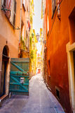 Narrow street in old part of Nice. Royalty Free Stock Image